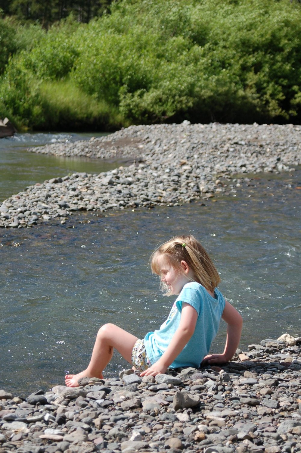 Playing in Soda Butte Creek located behind our VRBO cabin