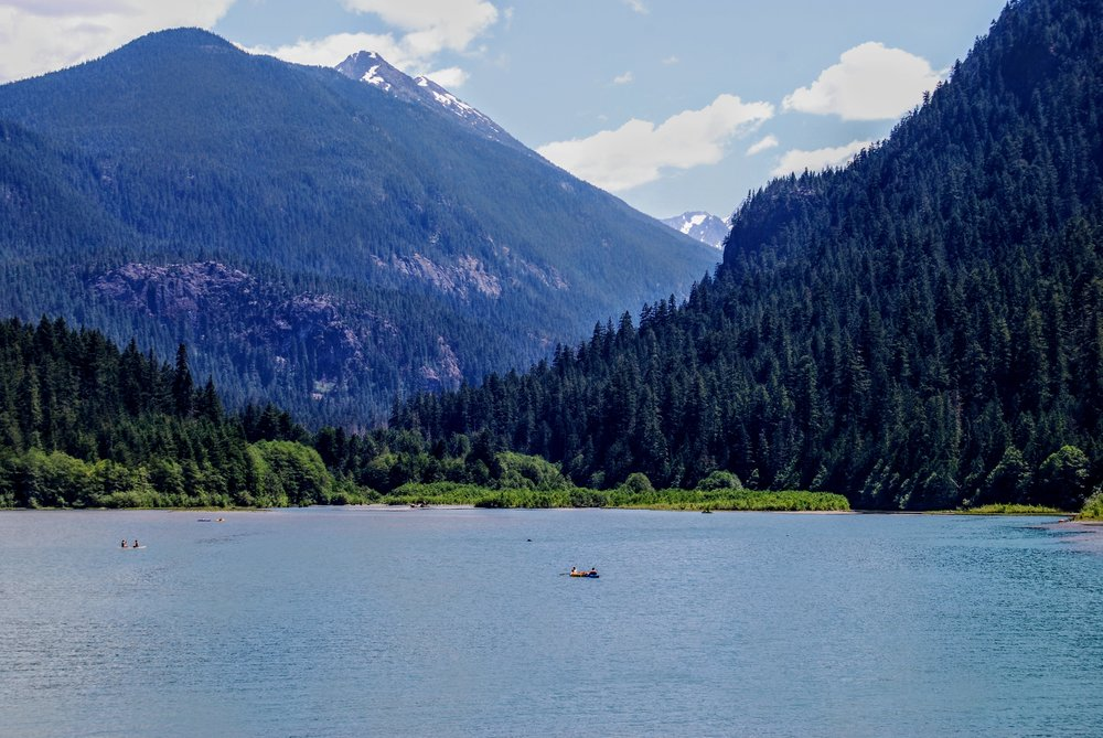 Canoeing and paddleboarding on Diablo Lake near Colonial Creek campsite.