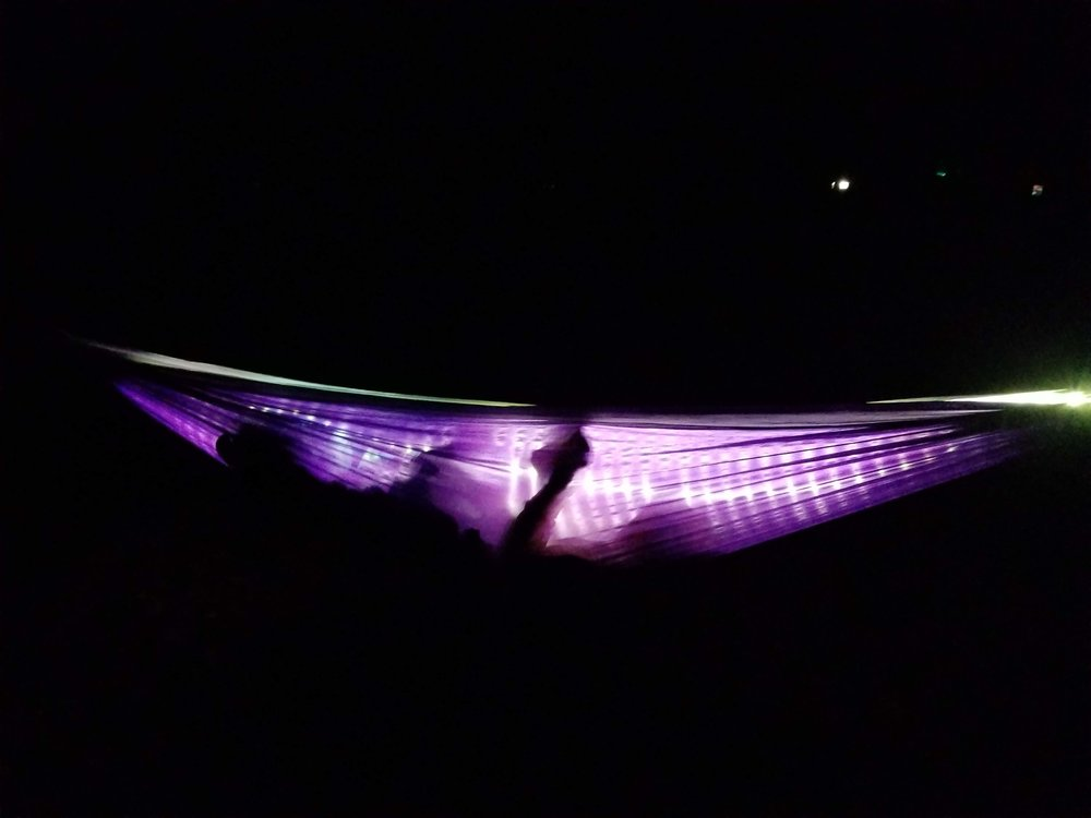 My nephew reading by the light of the Luminoodle in his hammock. It is amazingly bright.