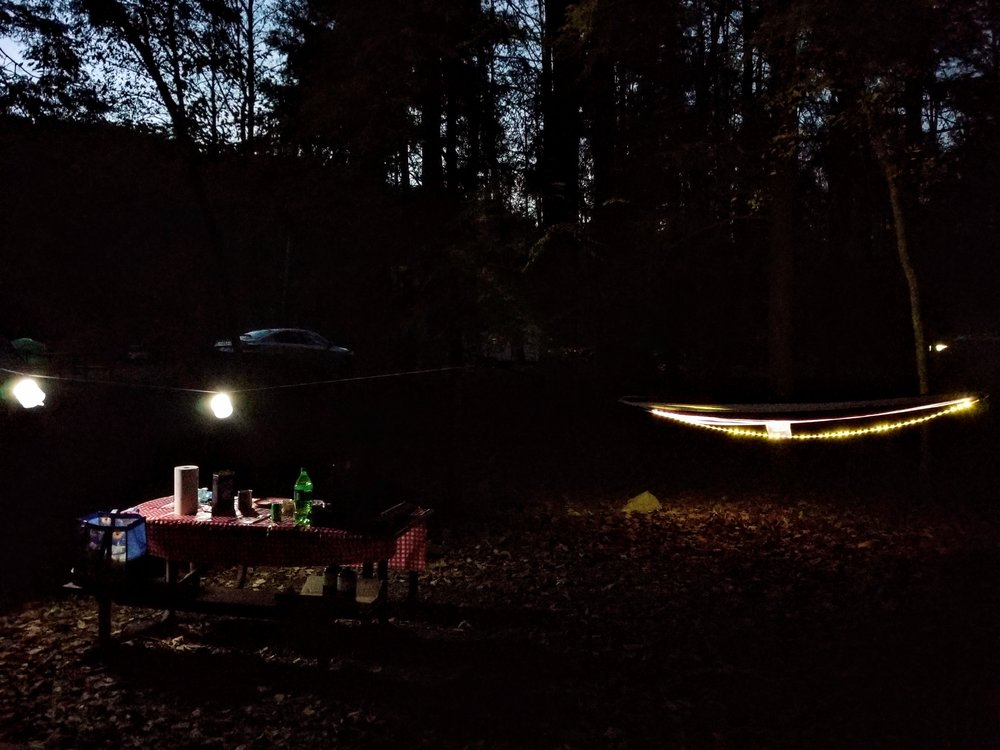 Luci lights hanging over the picnic table