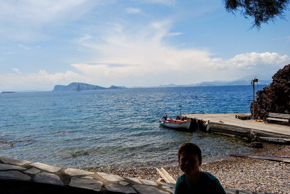 Taking a break from hiking around Hydra at a taverna on the water