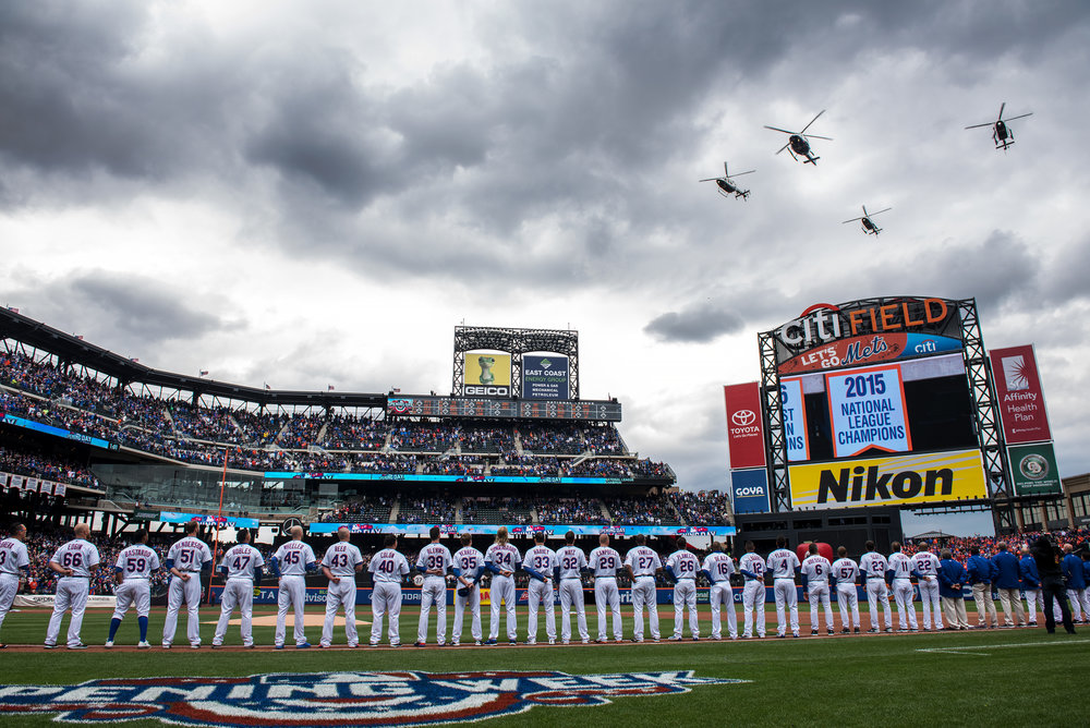 NYPD helicopters fly over Citi Field at the opening day ceremony for the New York Mets. The fly over honored 10 members of the NYPD and FDNY that have been injured in the line of duty.