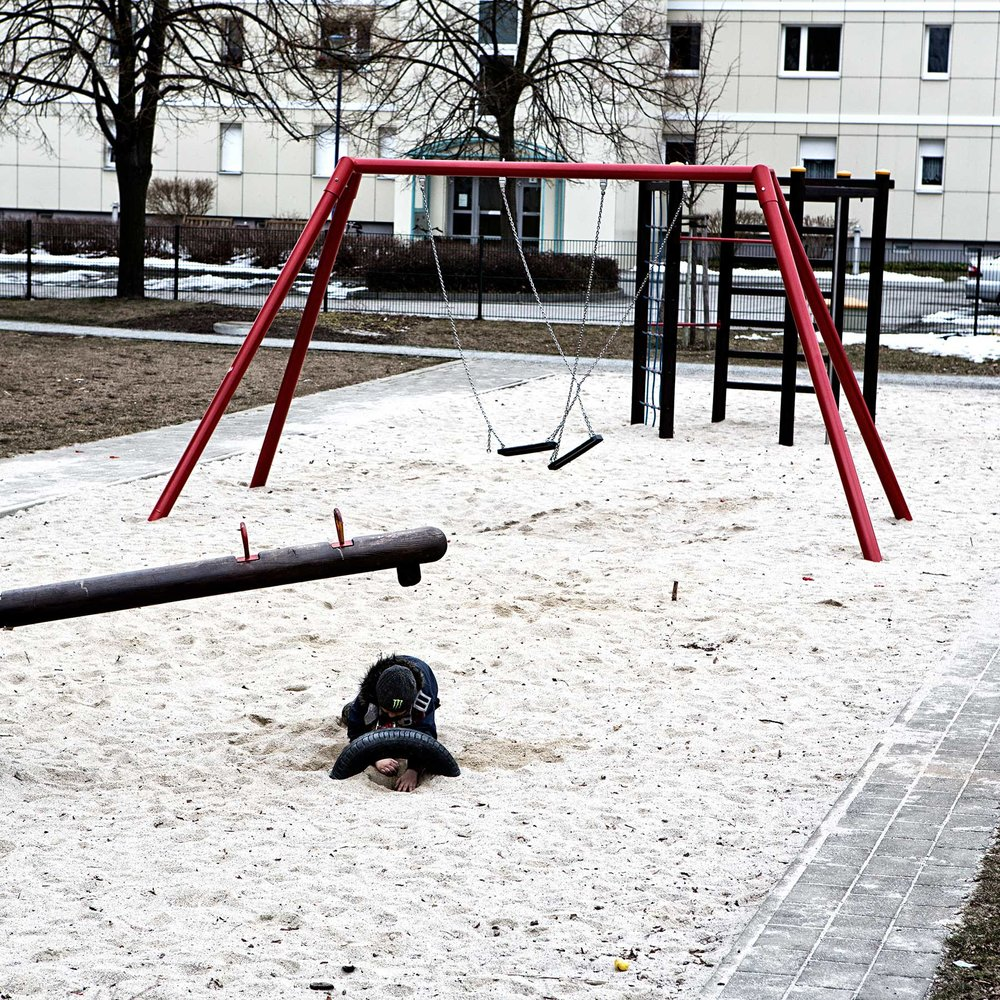 A young boy plays in the sand at a local playground. Hoyerswerda has plenty of playgrounds but most have just a few or no kids playing in them.
