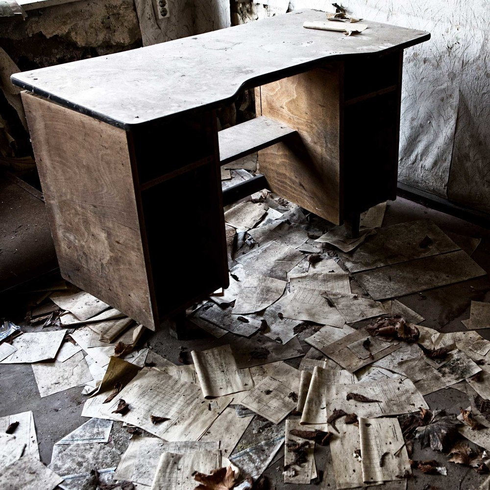 An empty desk inside of the old glass factory outside of Hoyerswerda.