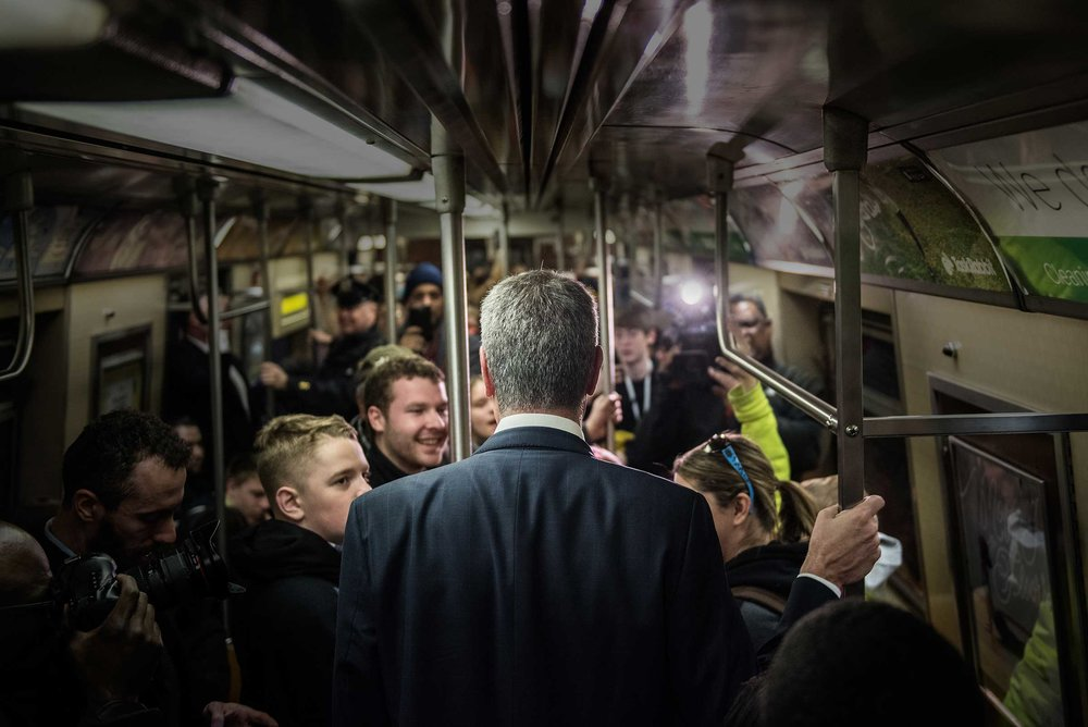 'Transportation to Work.' New York City Mayor Bill de Blasio surprise riders by taking the subway to City Hall.