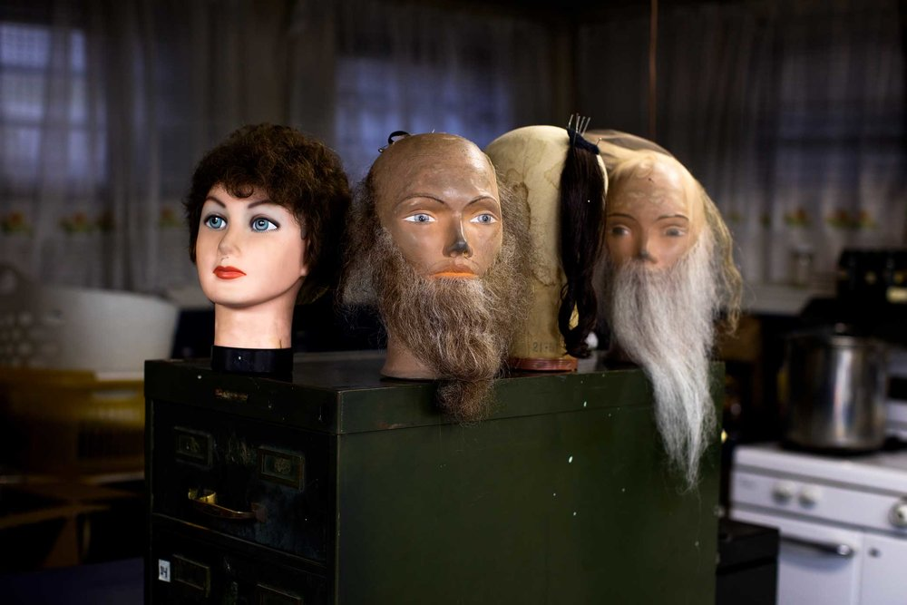 A Collection of head manikins at Claire Grunwald basement Wig Studio in Brooklyn. Claire Grunwald is the owner of Claire Accuhair, a Brooklyn wigs company that for fill customers orders by hand with authentic hair. The Orthodox community make up most of her clientele with orders of wigs and beards. Claire works along side her daughter's Chanie Handler, 56, Chaya Goldish, 64, and her Husband Moses Grunwald, 90.