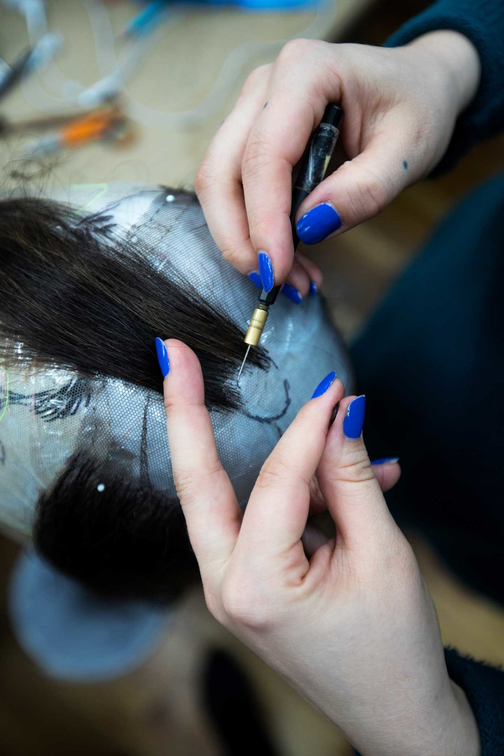 Chloe-nil Acerol works on a new wig at the Tom Watson Wig Design Studio in Manhattan. Tom Watson is the head of the wig and makeup department at the Metropolitan Opera.
