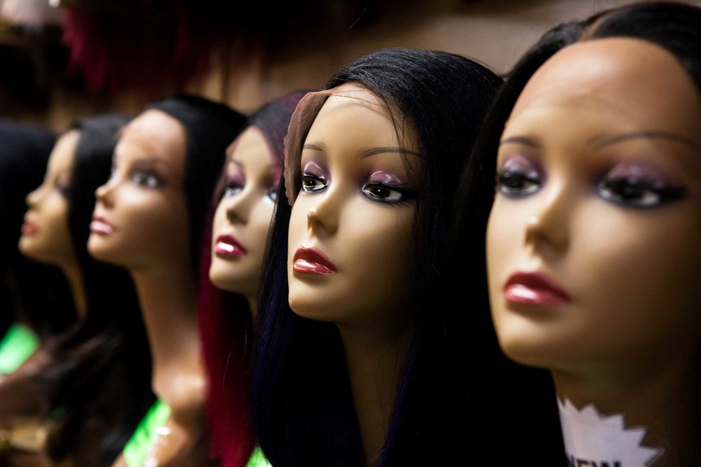 Wigs on display at Apollo Beauty Land in Harlem, Manhattan.