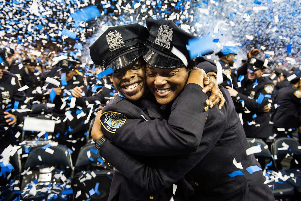 After 6 months in the police academy NYPD Graduate's celebrate during the NYPD Graduation ceremony at Madison Square Garden in Manhattan New York.