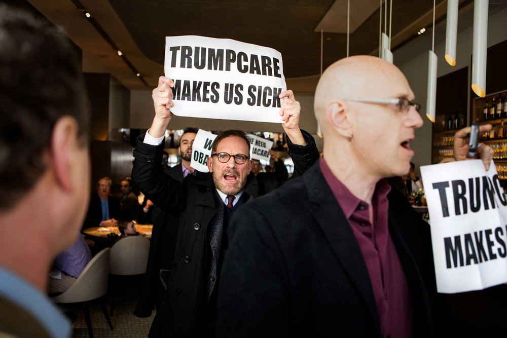 Protest at the Jean-Georges restaurant coordinated by the anti-Trump group Rise & Resist. Trump protesters are led out of the Jean-Georges Restaurant inside of the Trump International Hotel and Tower at Columbus Circle.