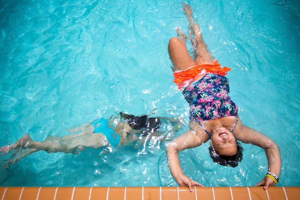 "Faith Brown and her cousin Sami Russell play in the swimming pool at her home in Brooksville, Florida. ""We swim everyday and play games in the pool. Its so much fun. I'm hoping to be on the swim team at my high school,"" said Faith. 14 year old Faith was diagnosed with cancer last year and has had most of the bones in her right leg replaced with metal implants. ""There are slight differences but I can still do things,"" said Faith. Faith plans to tryout for the swim team once she starts high school as a 9th grader."