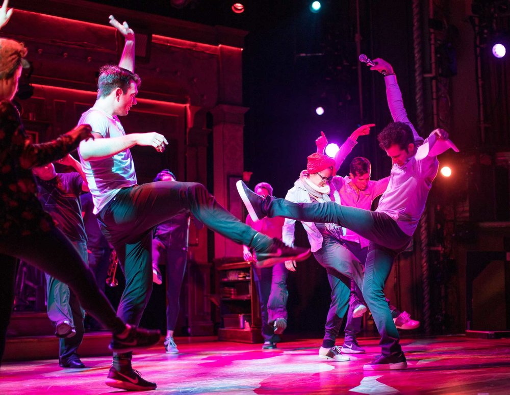 "Left, Director Andy Blankenbuehlerr demonstrates a dance move correction for the  Broadway Musical ""Bandstand"" cast during the last rehearsals at the Bernard B. Jacobs theater in Manhattan."