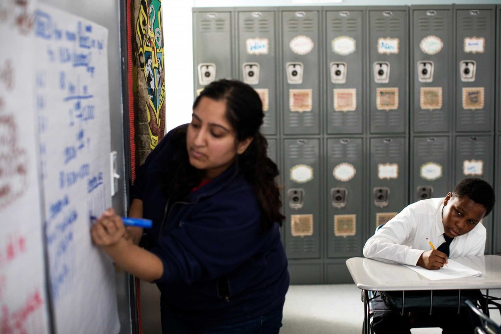 Math Teacher, Dhara Patel giving her students math lessons during class at Brooklyn Ascend Charter School in Brownsville. Ascend Charter School use new conflict-resolution practices in place of traditional discipline, such as formula suspensions and detention to solve problems. The school uses group dialogue called circles and student driven dialogue to resolve conflicts.