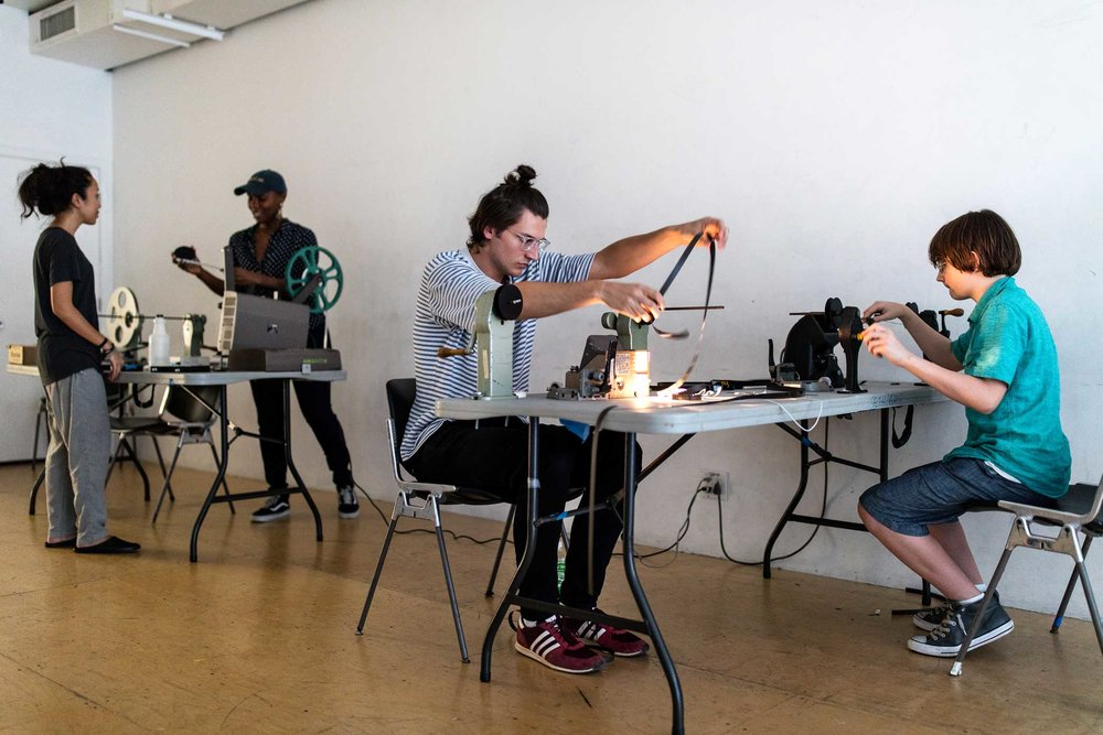 Right to left: Shane Fleming, 13, John Grunewald, 21, Ja' Tovia Gary, 32, and Inaya Yusuf, 29, in their work space at the Mono No Aware workshop space in Brooklyn.