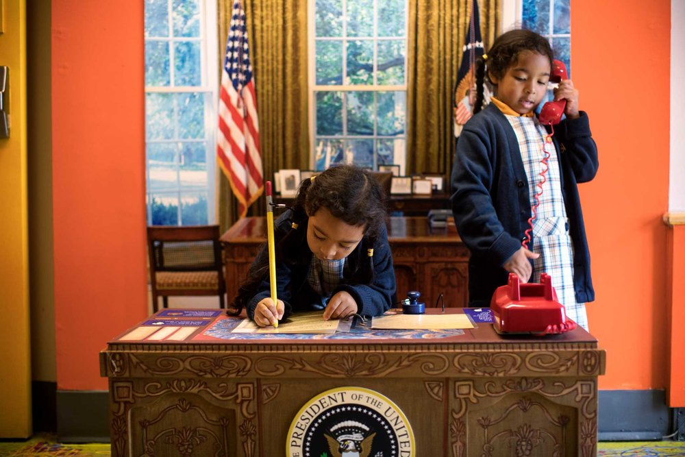 Young kids play at the Presidential Oval Office space at the Manhattan Children Museum in Manhattan, New York.
