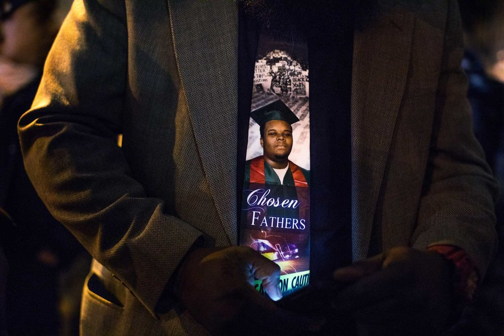 The father of Michael Brown, Micheal Brown Sr. wears a tie of his son to the funeral for Erica Garner at the First Corinthian Baptist Church in Harlem.