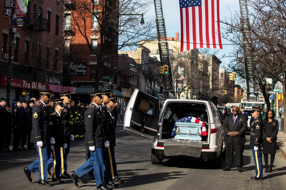 The arrival of Pfc. Emmanuel Mensah's coffin.