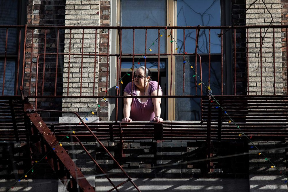 Local resident watch the arrival from her window.