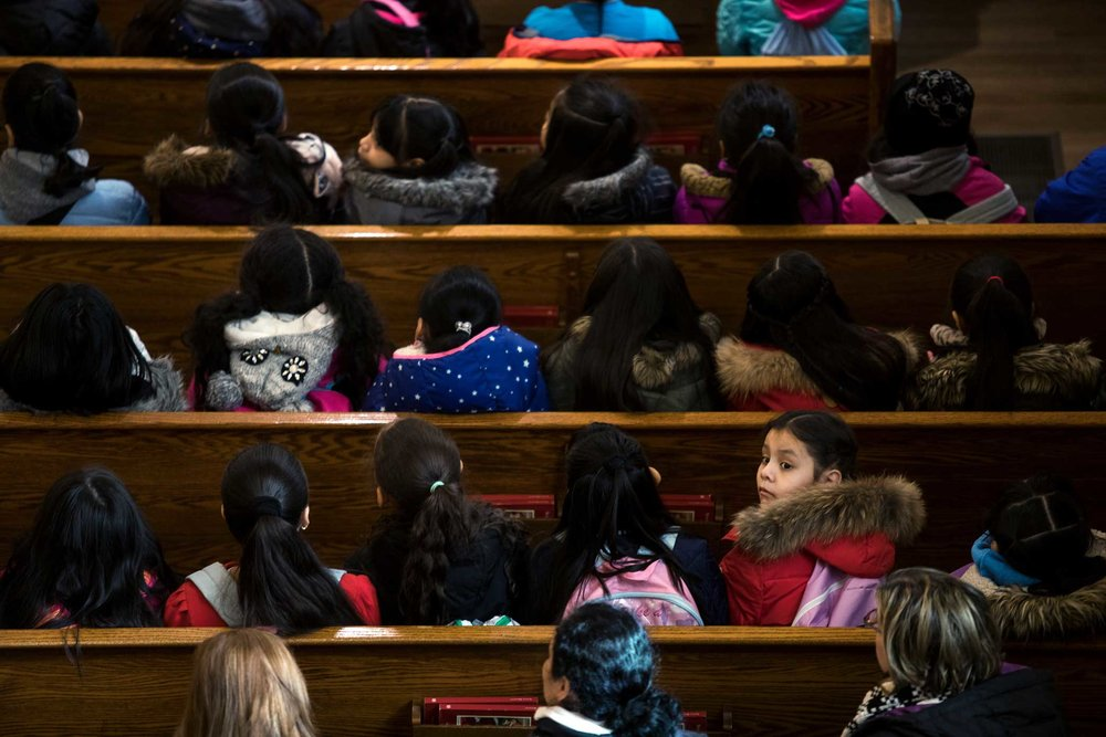A section of young children attending the funeral service for Private First Class Emmanuel Mensah at Mount Carmel's Catholic Church in the Bronx.
