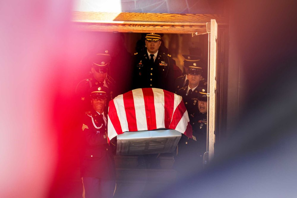 Private First Class Emmanuel Mensah coffin exiting the Mount Carmel's Catholic Church in the Bronx.
