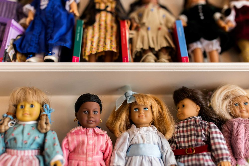 Collection of dolls arranged on the shelves at the resale boutique for American Girl Dolls store Girl A Gain in White Plains, New York.