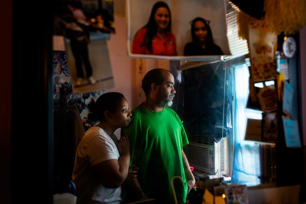 Shaly and Juan Ramirez in their children bedroom in Manhattan, New York. The children room wall suffered heavy water damage by a leaking pipe creating an intense mold issue.    Link to original story at The NRDC:  Inside NYC's Public Housing, Mold and Neglect Are a Dangerous Combo     Text by  Nicole Greenfield  for NRDC