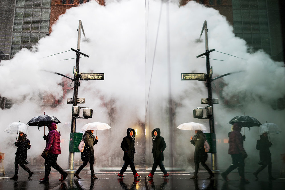 New Yorkers make their way down Broadway during snow fall in New York City.