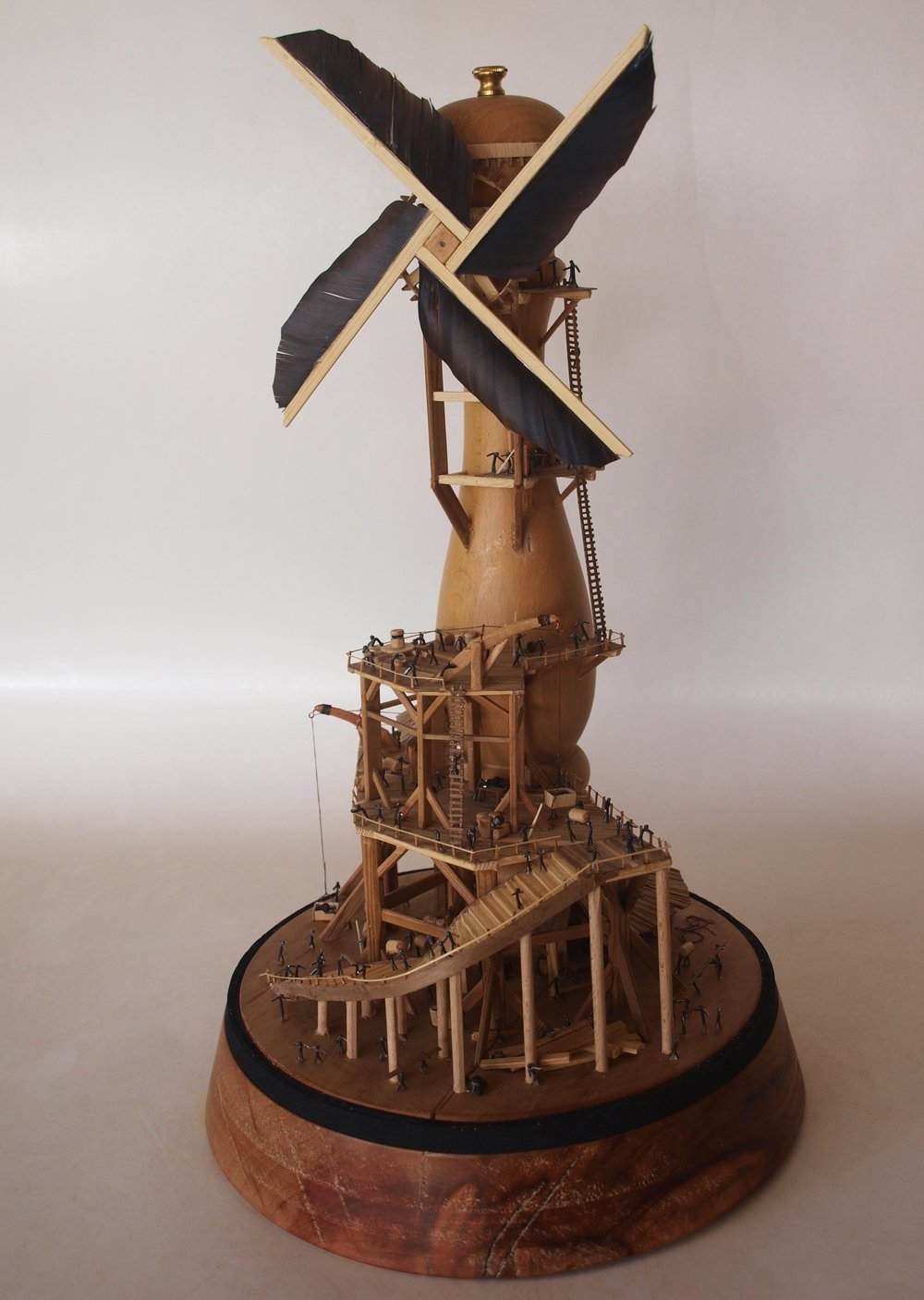 title, Making the wind work, size, 27cm section x 53cm height, materials, wood, fethers, iron yarn, Pepper grinder, 2015.jpg