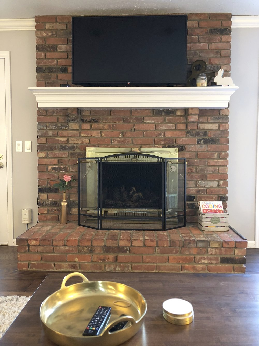 We decided our brick hearth was staying. We changed everything about this room but this.