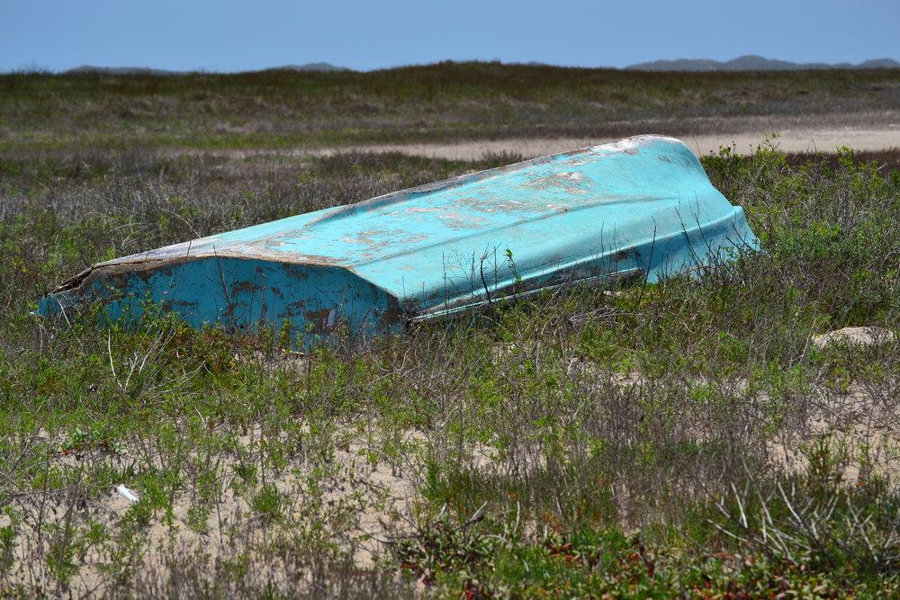 Storm wrecked boat on Cuba Island, a long ways behind the foredune ridge.