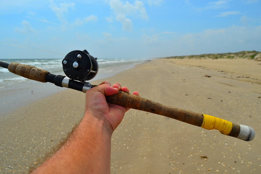 Fishing Ralph Wade's Pancho Brundidge rod.  - Padre Island National Seashore