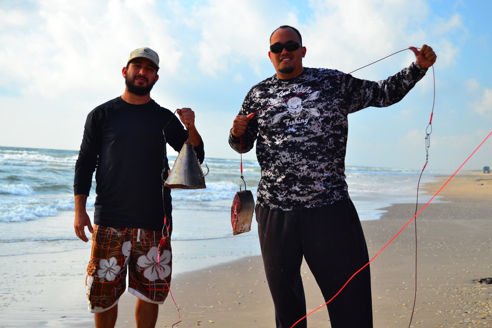 Philip and Fernando with fresh jackfish ready to run out for sharks.