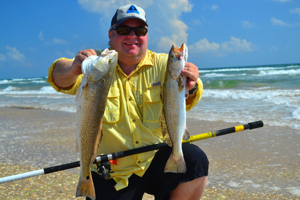 Scott with a double redfish and trout!