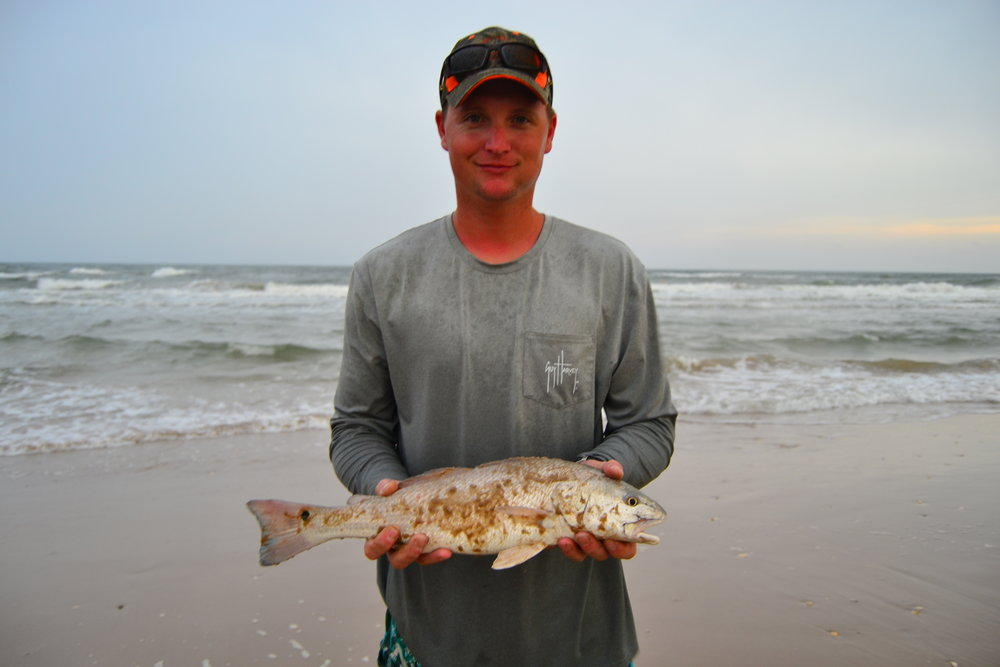 Randall Seigmund with a redfish on lure.