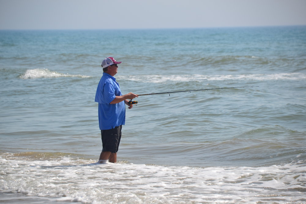 Lure fishing in the surf.