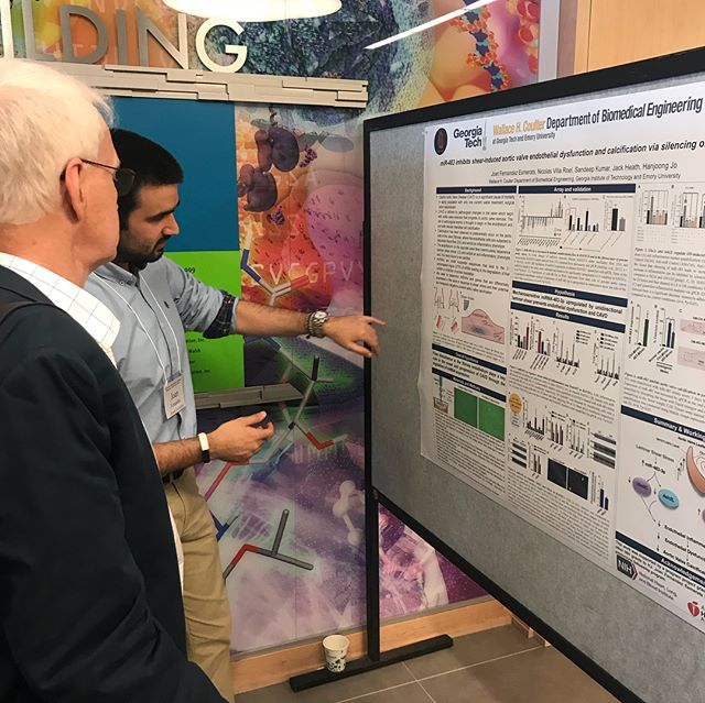 "Visit us during the poster sessions! Here is PhD candidate Joan Fernandez Esmerats presenting his research project titled ""miR-483 inhibits shear-induced aortic valve endothelial dysfunction and calcification via silencing of Ash2L and Ube2C"""