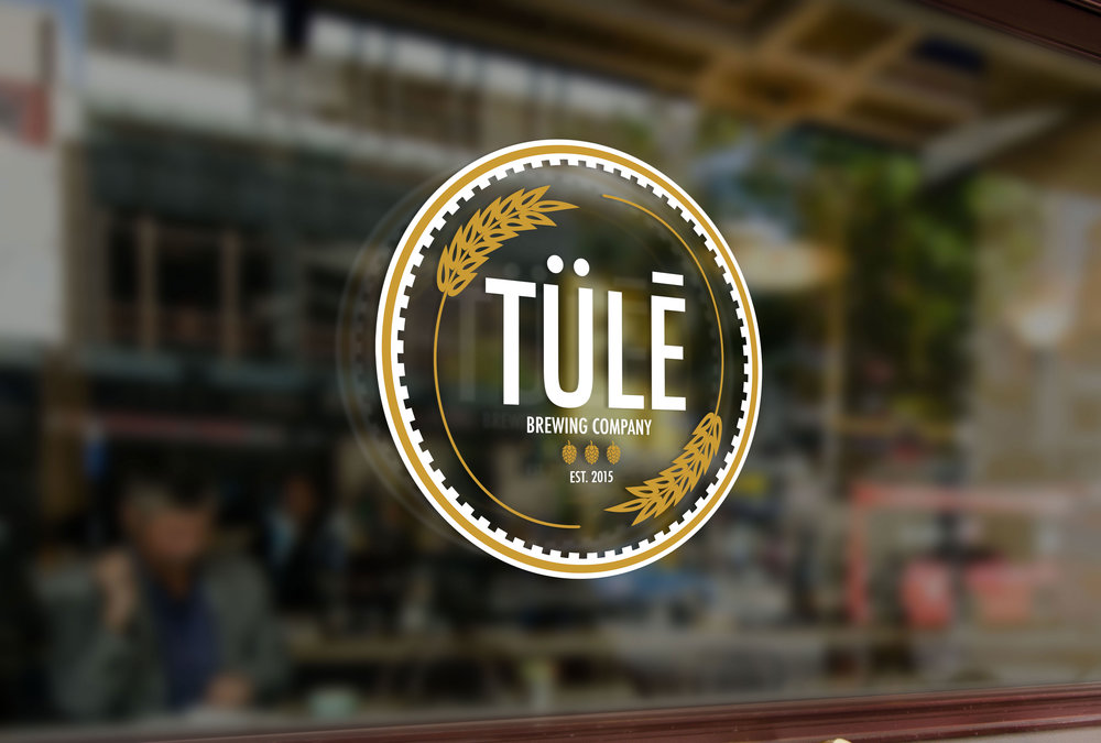 """Tülē Brewing Co."" is a branding logo I created for a startup brewing company based out of Springfield, MO. The client wished to incorporate hops and barley into a badge-style design, which I developed using Adobe Illustrator."