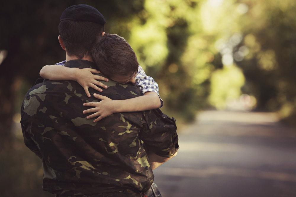 Little-boy-and-soldier-in-a-military-uniform-000080273841_Medium.jpg