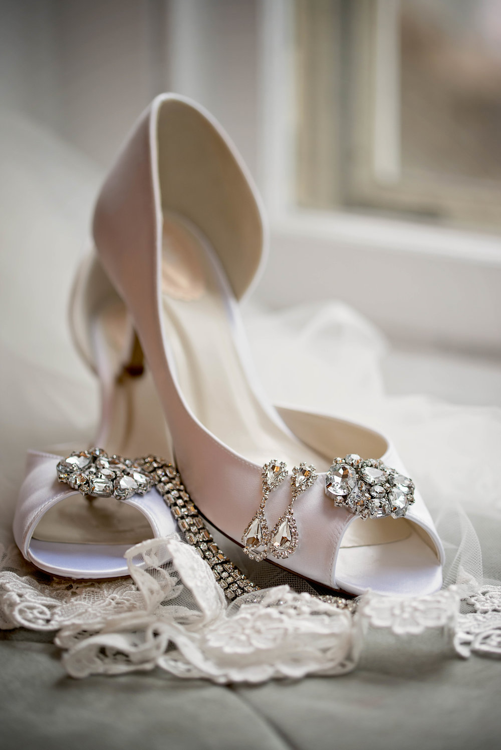 white bridal heels and jewelry in window in Houston Texas photo.jpeg