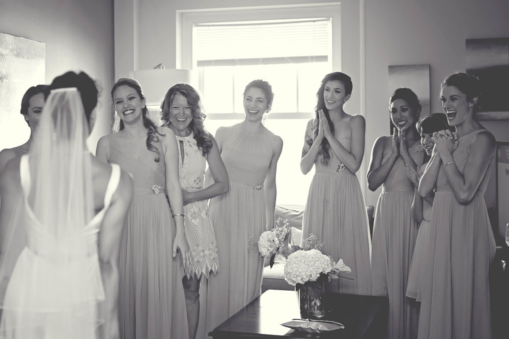 bridal first look with bridesmaids in hotel room at the john marshall in richmond virginia photo.jpeg