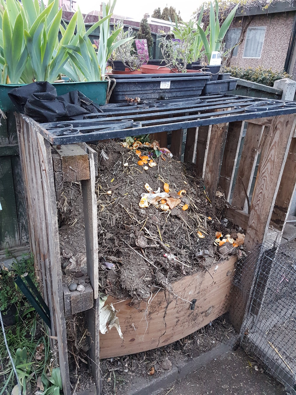 A rather ramshackle, recycled compost heap.