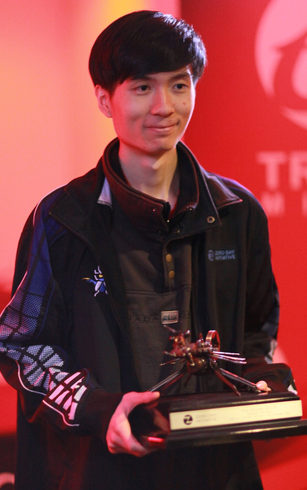 Richard Zhu (fluorescence) accepts the Master of Pwn trophy and jacket
