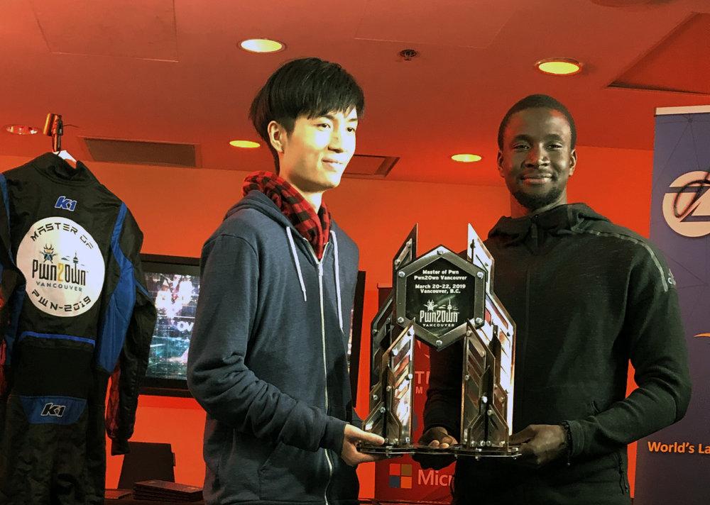 Master of Pwn winners Richard Zhu and Amat Cama - Team Fluoroacetate
