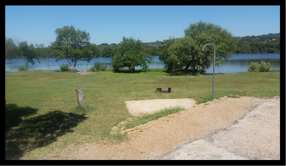 #274 is situated close to the lake but has optional level area situated farther back than other options at this camping site. There is a mild slope to the area but it also offers a cement pad, separate from the designated parking area.