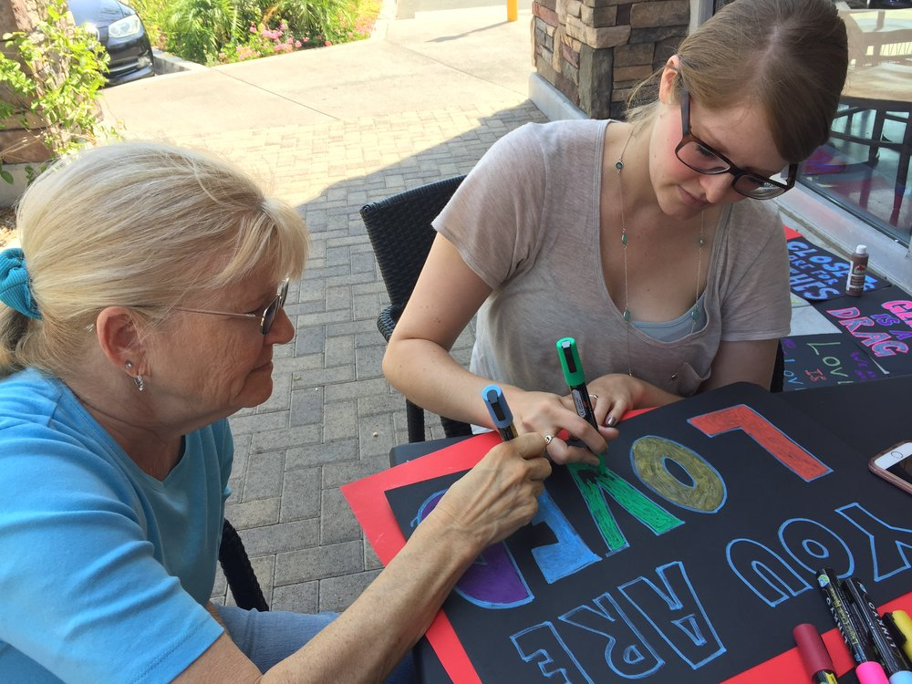 Last Saturday, more than a dozen Indivisible: Conejo activists gathered to lend their creativity to making signs to decorate our booth at Ventura County Pride (August 19 - RSVP below). In addition to the colorful creations that emerged, everyone who stopped by signed our LGBTQ+ flag banner. The banner will be at our Summer Bash on the 18th if you'd like to add your name!