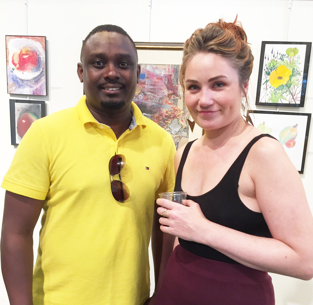 Andrew Ndayambaje (Guest Services Program Director) and Nicole Barquist (Art Therapist).JPG