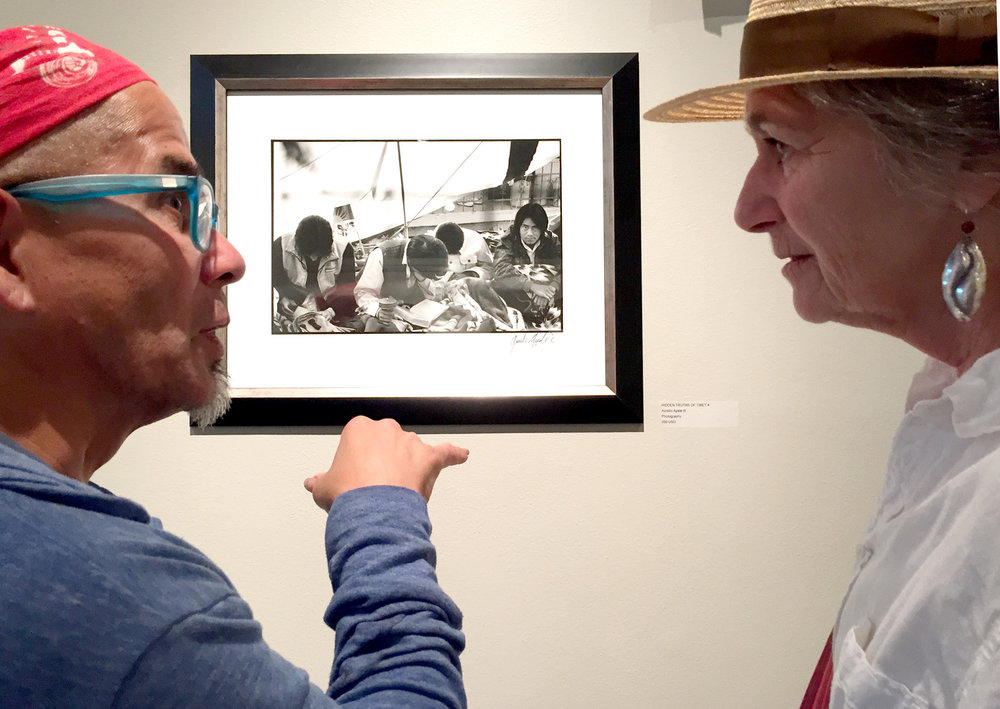 Photographer Aurelio Ayala III discusses his work with gallery associate Janet Cunningham.jpg
