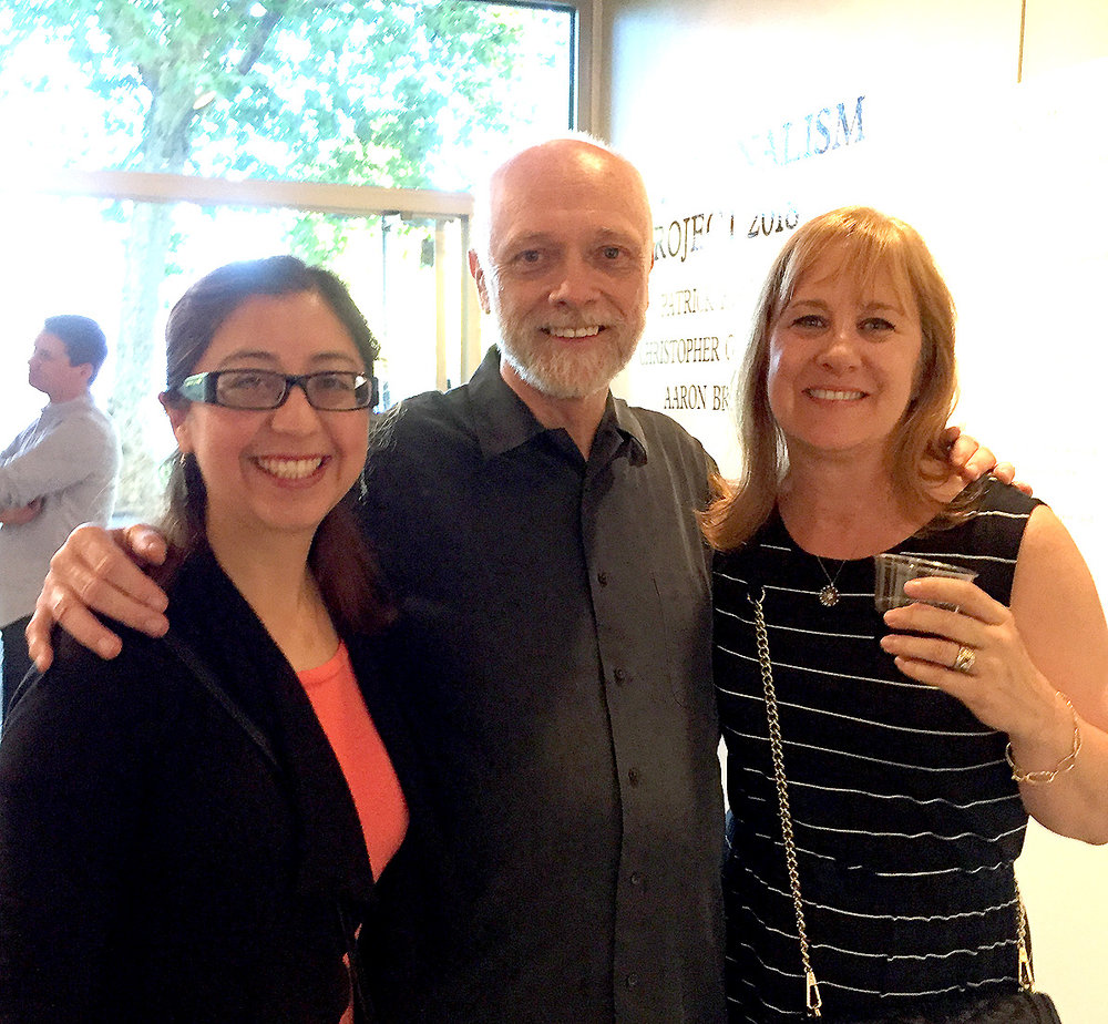 Post Personalism Show coordinator  Patrick Howe with opening night guests .jpg