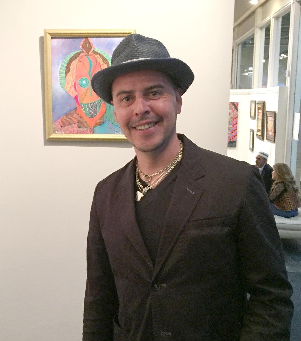 artist Aurelio with his painting Masque Africain  .jpg