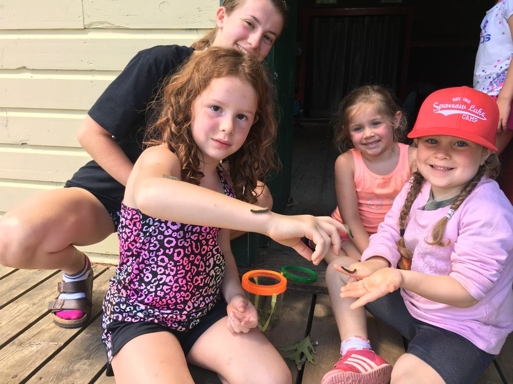 Some of the Cabin 6 Pee Wees with their four caterpillar friends and Counsellor Kayleigh!